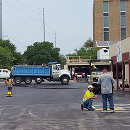 men working on parking lot striping